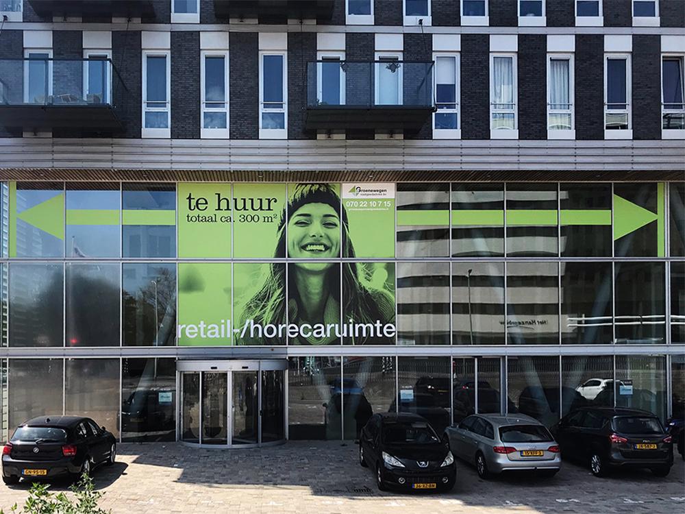 raamstickers vastgoed binckhorst den haag image building buitenreclame 1000x750