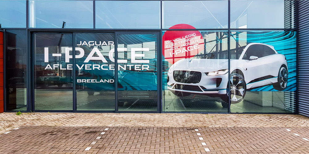 automotive reclame gevelreclame raamsticker jaguar image building 1000x500