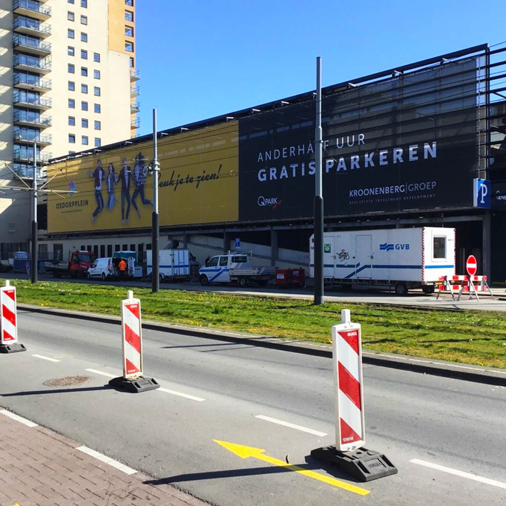 winkelcentrum reclame osdorpplein amsterdam aluminium buizenframe gevelreclame